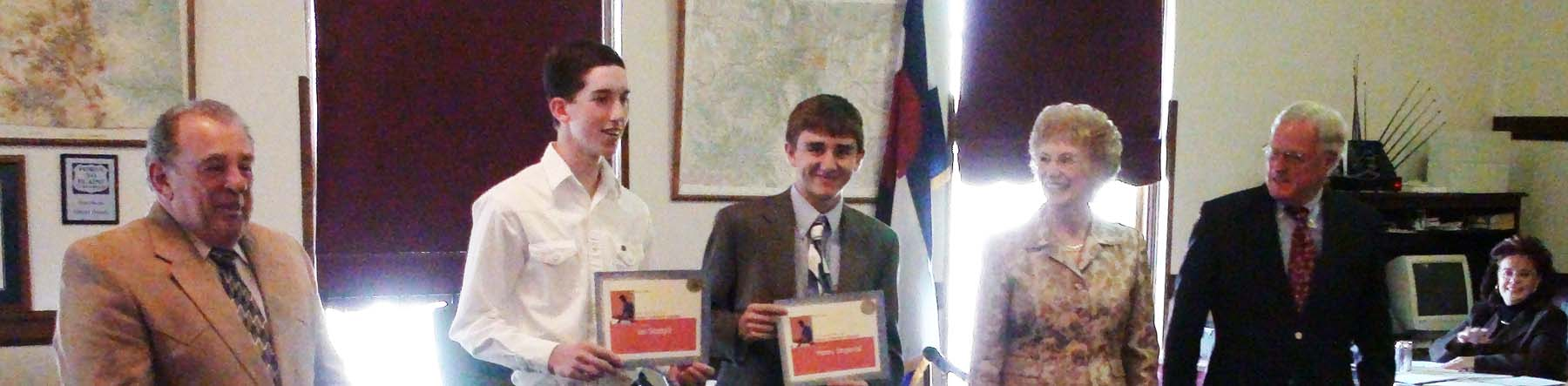 Ian and Henry receive commissioner award for essay contest