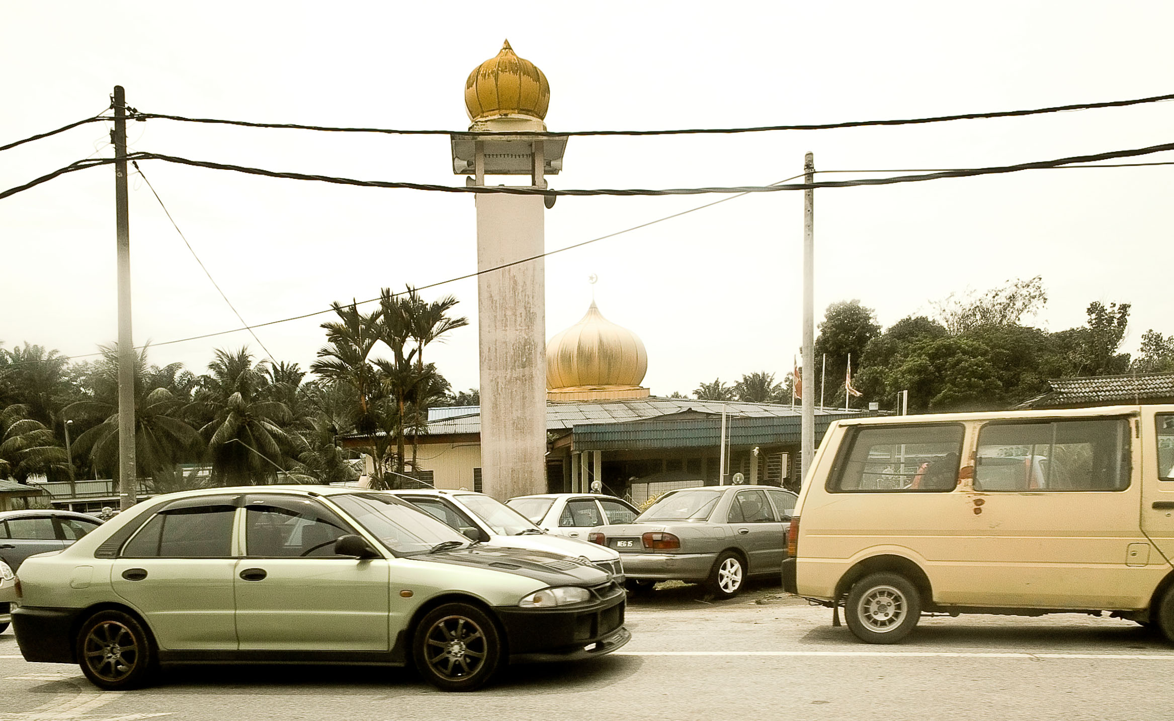 cars parked at Friday prayers in front of a mosque